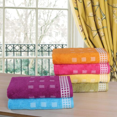 Excellence Bath Towels of varying colours stacked together
