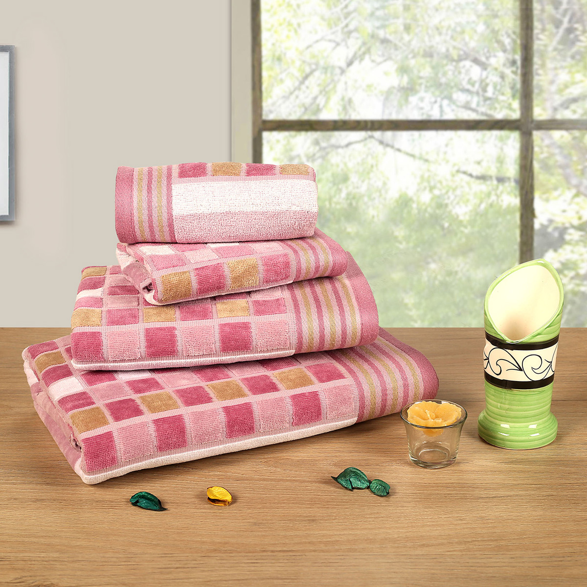 Pink coloured Lira Checks Bath Towels stacked