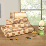 Brown coloured Lira Checks Bath Towels stacked