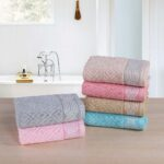 Louisa Bath Towels stacked in 2 piles