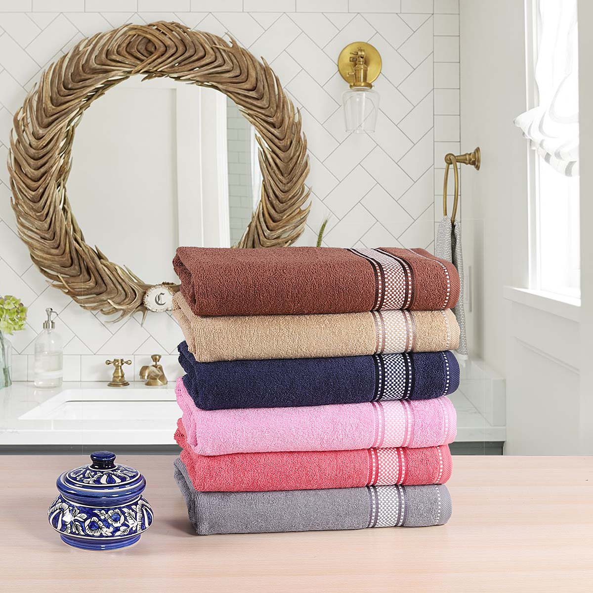 Noble Border Bath Towels of various colours stacked together